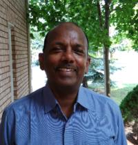 MUBARAK ALI THIWAN, EXECUTIVE DIRECTOR AND FRANCHISE OWNER